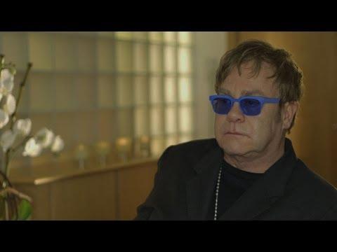Elton John AIDS Foundation - Unravel Travel TV Mp3