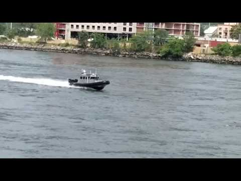 NYS Department Of Environmental Conservation Police Marine Unit Passing By On The East River