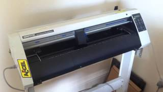 Graphtec cutting plotter CE5000 60 in operation cutting star shaped stickers