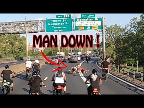 GUY FALLS HARD OFF MOTORCYCLE ON MANHATTAN BRIDGE !
