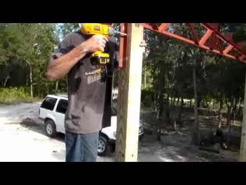 Build your own carport with steel trusses.