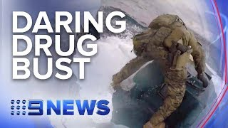 U.S. Coast Guard leaps onto moving submarine filled with cocaine | Nine News Australia