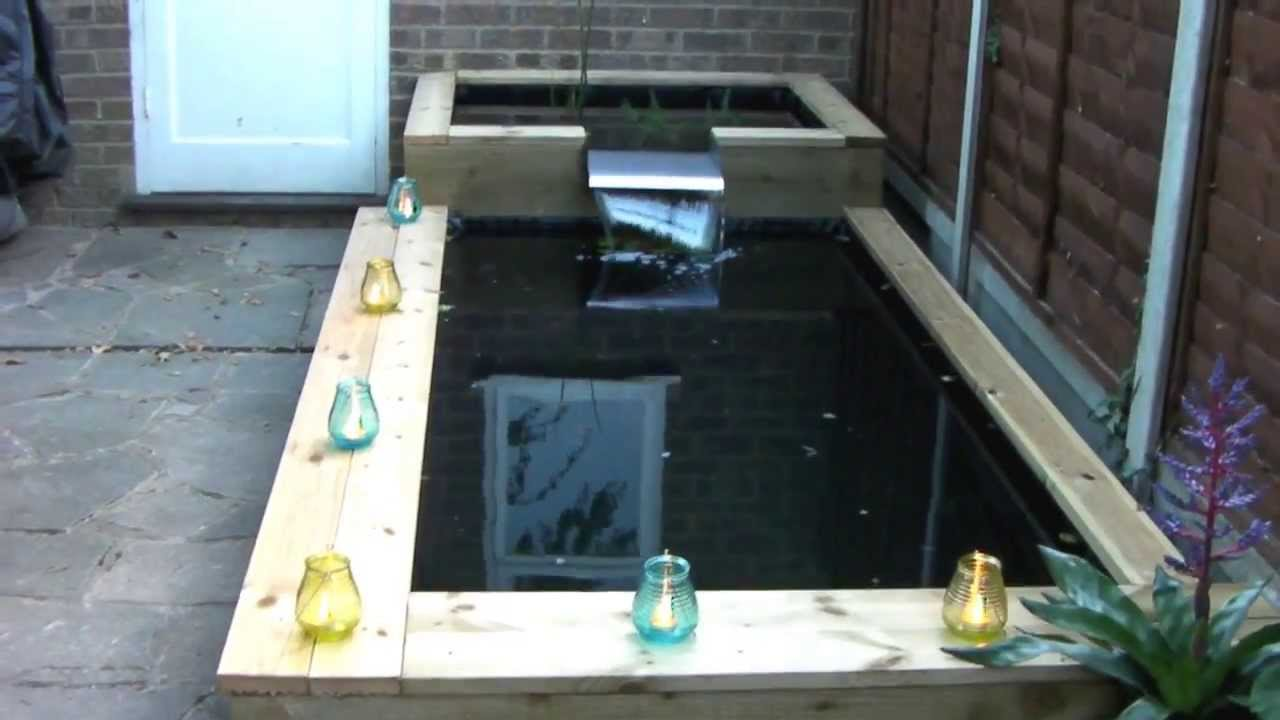 Railway sleeper wooden raised pond youtube for Pond made from pallets