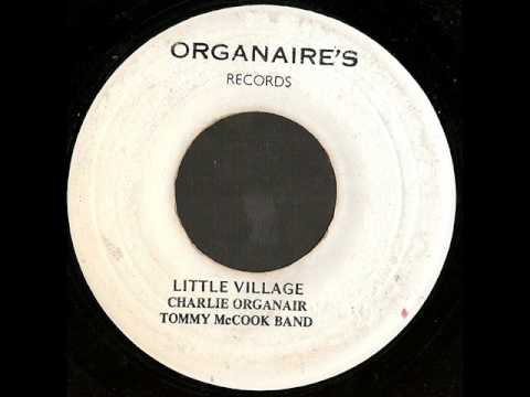 Charlie Organaire Little Village It Happens On A Holiday