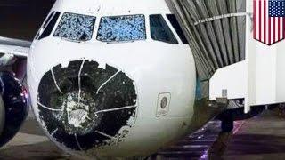Plane emergency landing: Delta flight lands blind after hail storm damages windshield - TomoNews