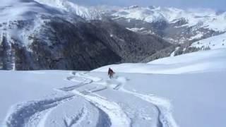 Caroline skiing in powder snow on Pischa Thumbnail