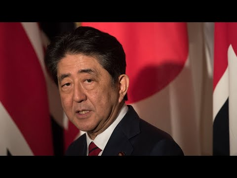 Japanese PM wins party election in landslide