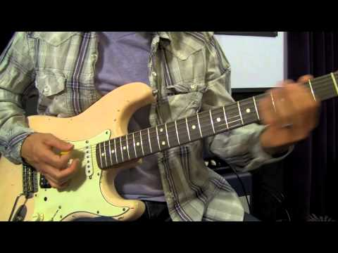 how to hold guitar chords