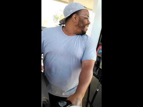 Fat boy putting gas in the car