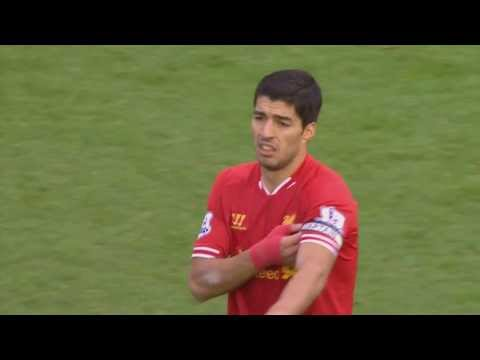 Luis Suarez handing the captain's armband to Daniel Agger
