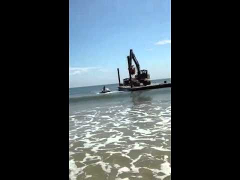 Barges work pulling Jetty