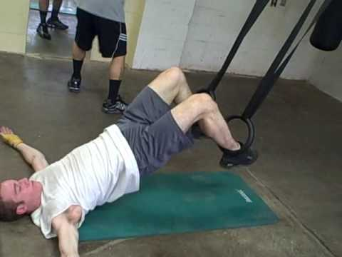 Supine Hip Extension With Knee Flexion Exercise  Using The Rings.