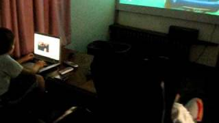 mike playing ps3 GTA4  on  optoma hd 20 projector  jamin on laptop