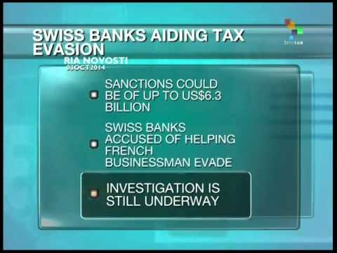 France accuses Swiss banks of aiding tax evasion