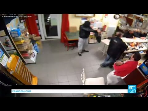 France - bar foiled robbery: Café owner fights off gunman with her handbag