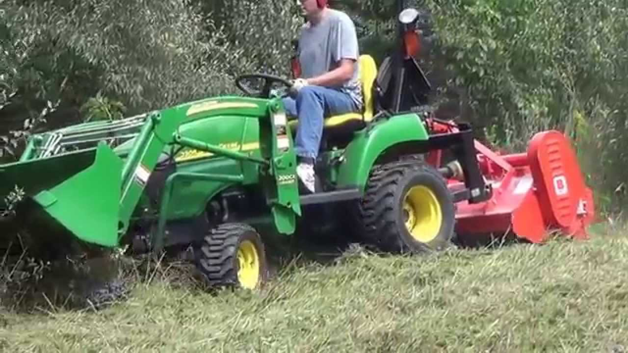 Flail Mowing Small Patch Of Tall Grass With Subcompact