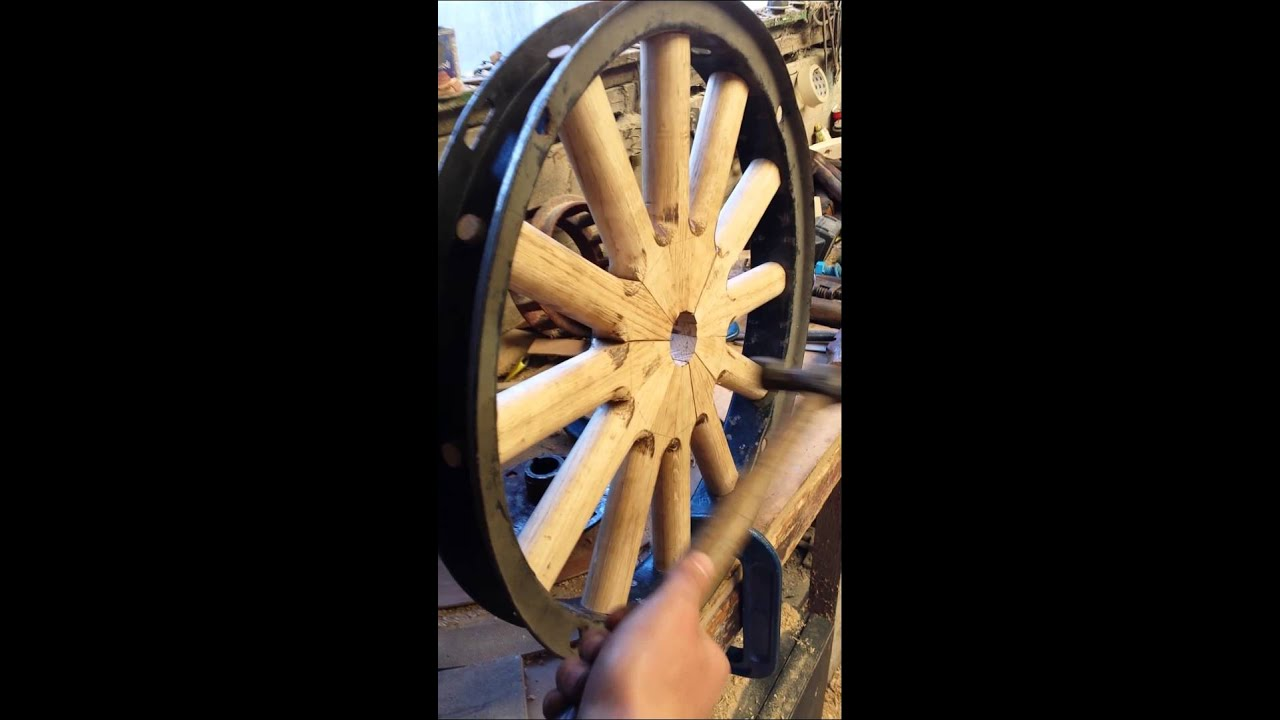 Vintage wooden car wheel spokes under compression - YouTube