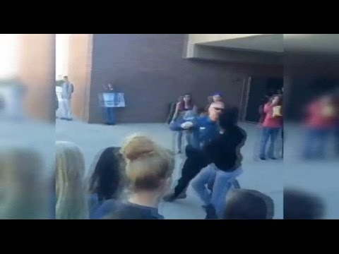Colo. cop hit while breaking up school fight