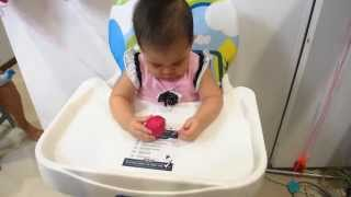 Hannah 1st Birthday - Unpeeling her red egg