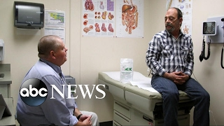 Deep in the heart of coal country, folks watch the health care battle