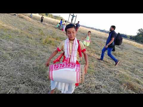 A six years old child play the Assamese traditional instrument dhol