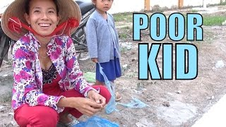 I help out a poor kid in the Mekong. Vietnam charity video.