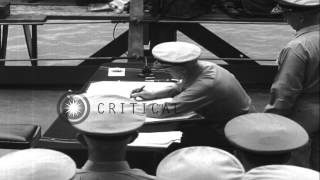 Japanese delegate signs surrender document during surrender ceremonies in Tokyo B...HD Stock Footage
