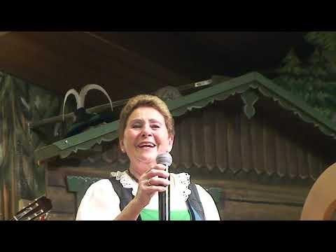 Yodelling Song Performed By The Gundolf Family In Innsbruck / Austria