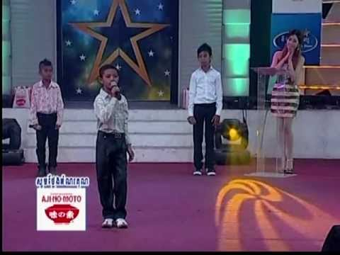 2 / Khmer boy sing for international children's day