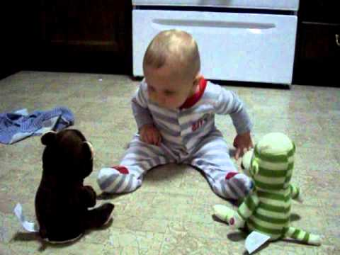 Baby dancing to singing stuffed animals