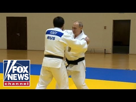 Putin trains with Russian judo champions