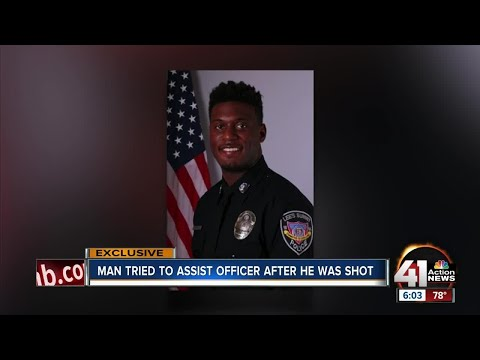 Man tried to assist officer after he was shot