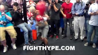 MIGUEL COTTO WORKS HIS SPEED AND TIMING ON THE DOUBLE END BAG