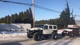 Jeeps and ford raptor rescuing a semi truck