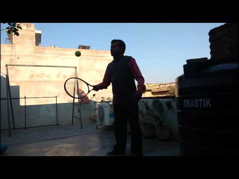 Longest Time Bouncing A Tennis Ball Using Alternate Sides Of A Tennis Racket