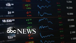 Stock market hits record highs as economy rebounds