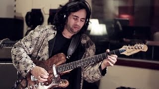 "Arli Liberman and his band records with his Langcaster guitar in the studio  ""Billie Jean""."