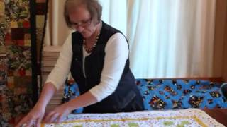 This video talks about where to start free-motion machine quilting,...