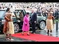 Queen Elizabeth smiles as topless men greet her in Norwich