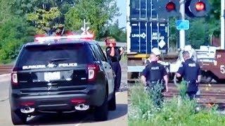 Police Helping Fix Railroad Crossing Gate