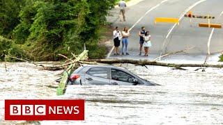 Sydney rains: Record rainfall brings flooding but puts out mega-blaze - BBC News