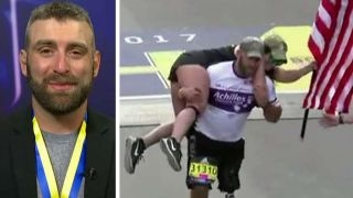 Wounded vet completes Boston Marathon with American flag