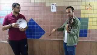 اندرو ومؤمن .. الحان كمان ورق في أنفاق الإسكندرية