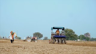 Middle-aged peasant plowing his field for cultivation - mechanized farming in India