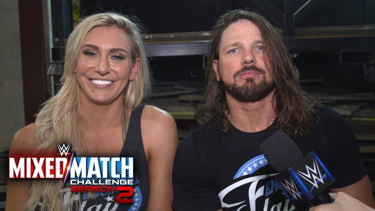 charlotte-flair-aj-styles-engage-in-a-post-match-woo-off