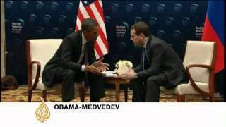 Obama and Medvedev exchange caught on open microphone