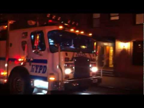 NYPD HOSTAGE TEAM, NYPD TECHNICAL ASSISTANCE UNIT, NYPD EMERGENCY SERVICES TRUCK 2, AMBULANCES.