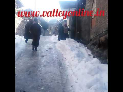 A Man Pours Salt On Icy Roads In Kangan To Melt Ice