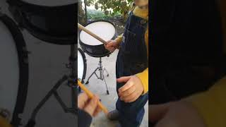 Kid plays drums for the first time