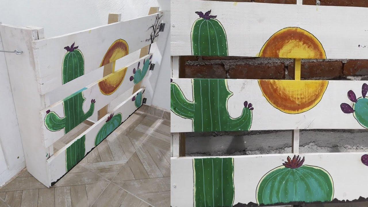 Decorando puerta de madera reciclada con pinturas acrílicas.